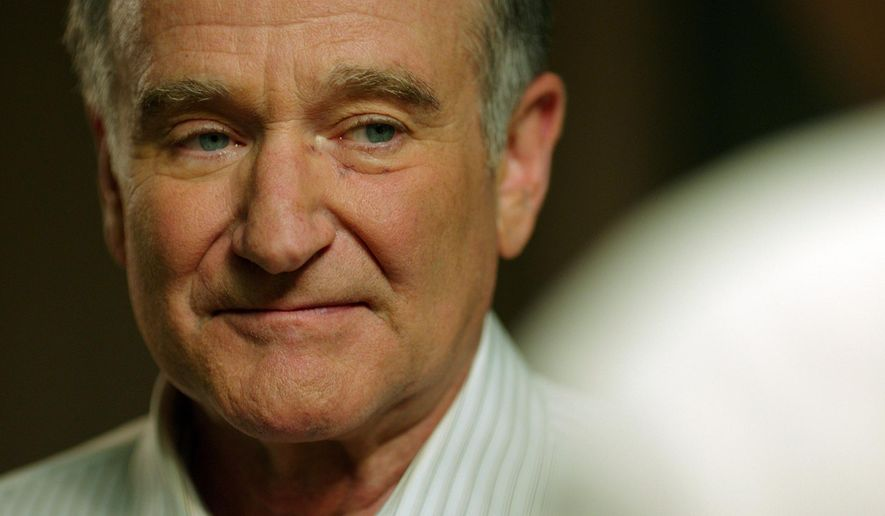 """In this image released by Starz Digital, Robin Williams appears in a scene from the film, """"Boulevard."""" In the film, Williams plays a closeted gay man who comes out in his 60's and then leaves his lifelong love, his wife of 40 years, played by Kathy Baker. (Starz Digital via AP)"""