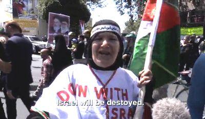 Iranian English teacher Fatemeh Hossieni, 61, celebrates Al-Quds Day in Tehran, Iran by calling for the destruction of Israel, July 10, 2015. (Image: NBC News screenshot) ** FILE **