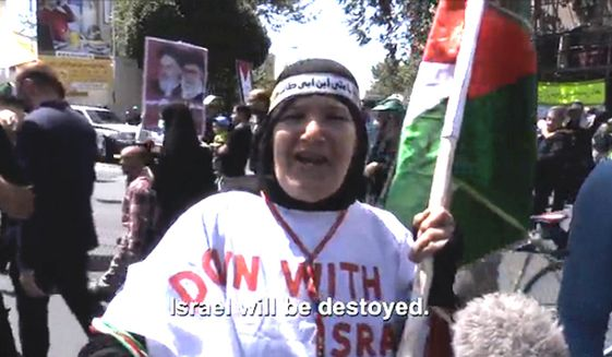 Iranian English teacher Fatemeh Hossieni, 61, celebrates Al-Quds Day in Tehran, Iran by calling for the destruction of Israel, July 10, 2015. (Image: NBC News screenshot) ** FILE **