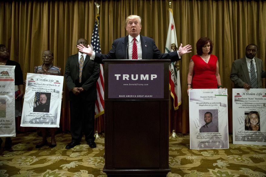 Republican presidential candidate Donald Trump, center, speaks at a news conference as he is joined by individuals who identify themselves as family members of victims who were killed, Friday, July 10, 2015, in Beverly Hills, Calif. Trump also discussed immigration during the news conference. (AP Photo/Jae C. Hong)