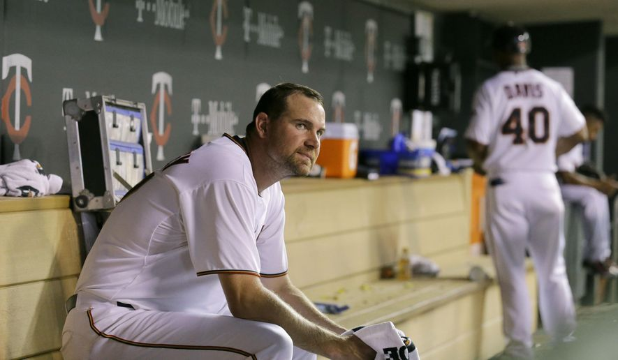 Minnesota Twins starting pitcher Mike Pelfrey sits in the dugout after being replaced by Blaine Boyer during the eighth inning of a baseball game against the Detroit Tigers in Minneapolis, Thursday, July 9, 2015. The Tigers won 4-2. (AP Photo/Ann Heisenfelt)