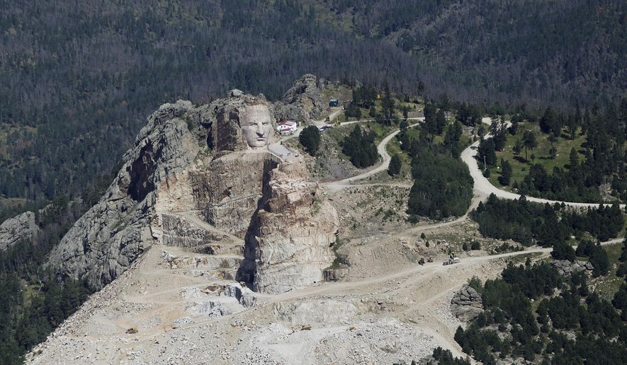 This Aug. 14, 2014 aerial photograph shows the Crazy Horse Memorial being carved in a hillside near Hill City, S.D. Officials are planning to market the Black Hills region of western South Dakota to China, Germany and the United Kingdom with videos about attractions such as the Crazy Horse Memorial. Crews will begin three days of filming Black Hills attractions on Monday, July 13, 2015.. (Chris Huber/Rapid City Journal via AP) TV OUT; MANDATORY CREDIT (REV-SHARE)