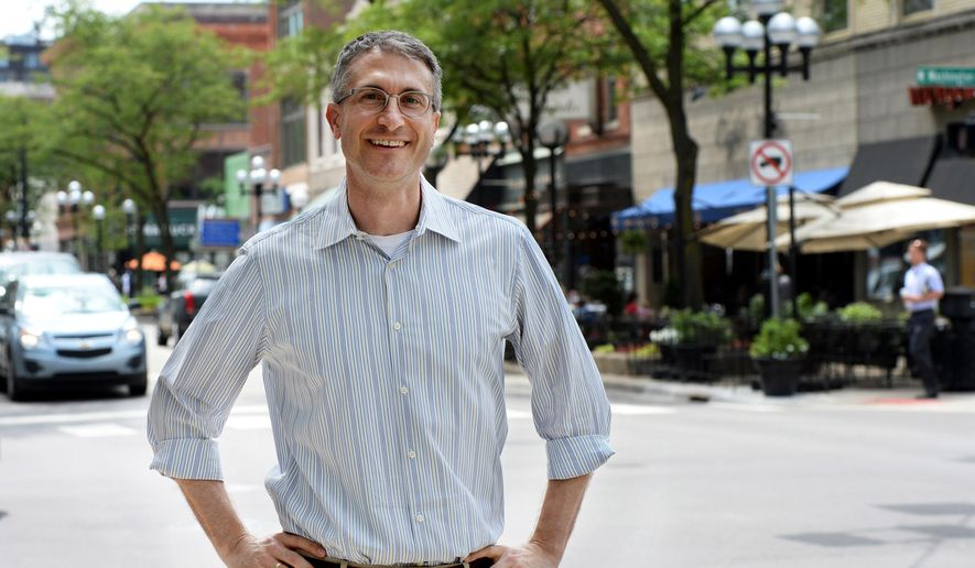 In this photo taken on Wednesday, Aug. 6, 2014, Ann Arbor, Mich., Mayor Christopher Taylor, poses for a photograph in downtown Ann Arbor. (Melanie Maxwell/The Ann Arbor News via AP) ** FILE **