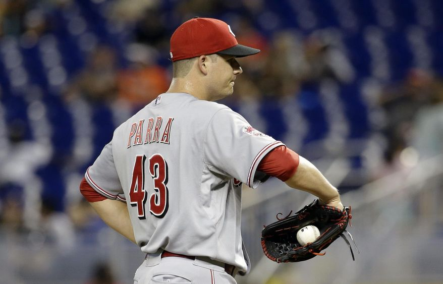 Cincinnati Reds relief pitcher Manny Parra stands on mound in the seventh inning of a baseball game against the Miami Marlins, Saturday, July 11, 2015, in Miami. Parra gave up five runs in the seventh without retiring a batter. The Marlins defeated the Reds 14-3. (AP Photo/Lynne Sladky)