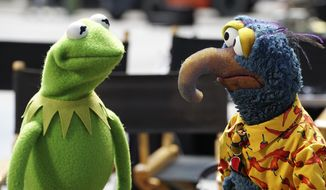 """Kermit the Frog, left, appears with Gonzo the Great in """"The Muppets."""" (Eric McCandless/ABC via AP) ** FILE **"""