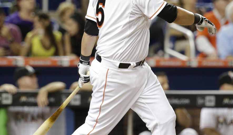 Miami Marlins' Casey McGehee (5) watches after hitting a double in the eighth inning of a baseball game against the Cincinnati Reds, Friday, July 10, 2015, in Miami. The Reds defeated the Marlins 1-0. (AP Photo/Lynne Sladky)