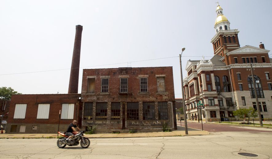 New bar The Smokestack located on 7th and White Streets in Dubuque, Iowa, Friday, July 3, 2015. The smokestack was installed in 1930 when the building was owned by the Sanitary Dairy. (Jake Crandall/Telegraph Herald via AP)