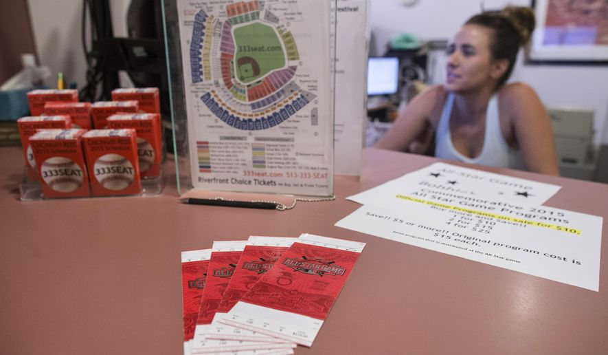 This photo shows All-Star Baseball Game tickets at Riverfront Choice Tickets, which also goes by 333seat.com, Friday, July 10, 2015, in Cincinnati. With the game sold out for weeks and the host city within a six-hour drive for fans in a half-dozen other MLB cities, online sites and ticket brokers are seeing prices jumping well beyond typical levels for the annual game. (AP Photo/John Minchillo)