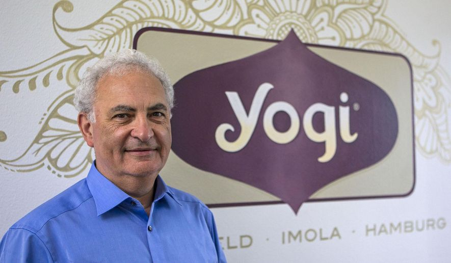 ADVANCE FOR USE SUNDAY, JULY 12, 2015, AND THEREAFTER- In this July 3, 2015, photo, Conrad Myers, CEO of Yogi, visits one of their manufacturing plants and sales office in Springfield, Ore.  Fueled by growing demand for its lineup of hot teas, the maker of Yogi Tea plans to roughly double its space by building a facility in west Eugene. (AP Photo via Mary Jane Schulte/The Register-Guard)