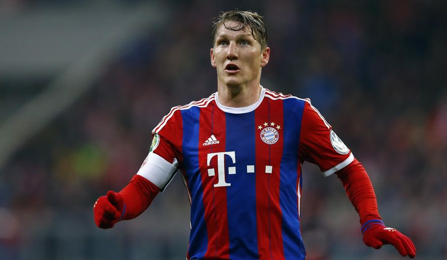 """FILE - In this March 4, 2015 file picture Bayern's Bastian Schweinsteiger watches the ball during the German Soccer Cup round of sixteen match between FC Bayern Munich and Eintracht Braunschweig in Munich, southern Germany/ . Bayern Munich chairman Karl-Heinz Rummenigge says Bastian Schweinsteiger is leaving the club for Manchester United. Rummenigge says Saturday July 11, 2015 """"we tried to convince him to stay at Bayern Munich, but I have a bit of understanding for a player who has been 17 years at the club, that he wants to try something different.""""  (AP Photo/Matthias Schrader,file)"""