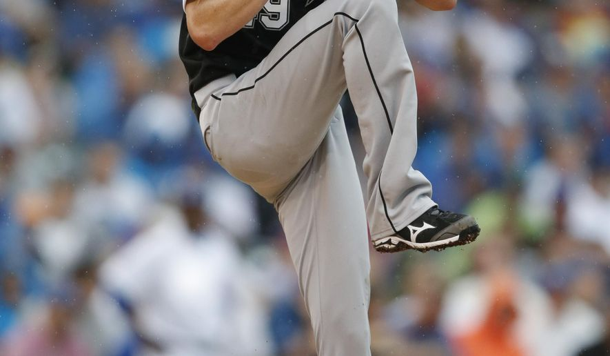 Chicago White Sox starting pitcher Chris Sale throws against the Chicago Cubs during the fifth inning of a baseball game in Chicago, Saturday, July 11, 2015. (AP Photo/Andrew A. Nelles)