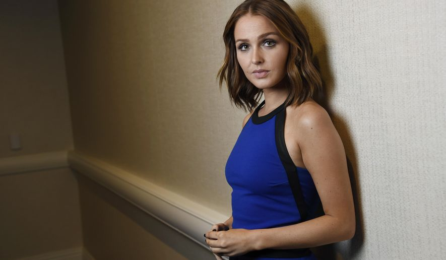 """Actress Camille Luddington, who provides the voice and motion capture of Lara Croft in the """"Tomb Raider"""" video games, poses for a portrait at the Manchester Grand Hyatt Hotel during the 2015 Comic-Con International on Saturday, July 11, 2015, in San Diego, Calif. (Photo by Chris Pizzello/Invision/AP)"""