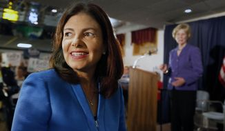 FILE - In this Tuesday, June 30, 2015, file photo, U.S. Sen. Kelly Ayotte, R-N.H., smiles before announcing her plans to seek a second term in Manchester, N.H. With negotiations on the state budget likely stalled until the fall, New Hampshire Gov. Maggie Hassan's political future remains in a holding pattern. National Democrats hope to recruit her to run for U.S. Senate against Ayotte. (AP Photo/Jim Cole)