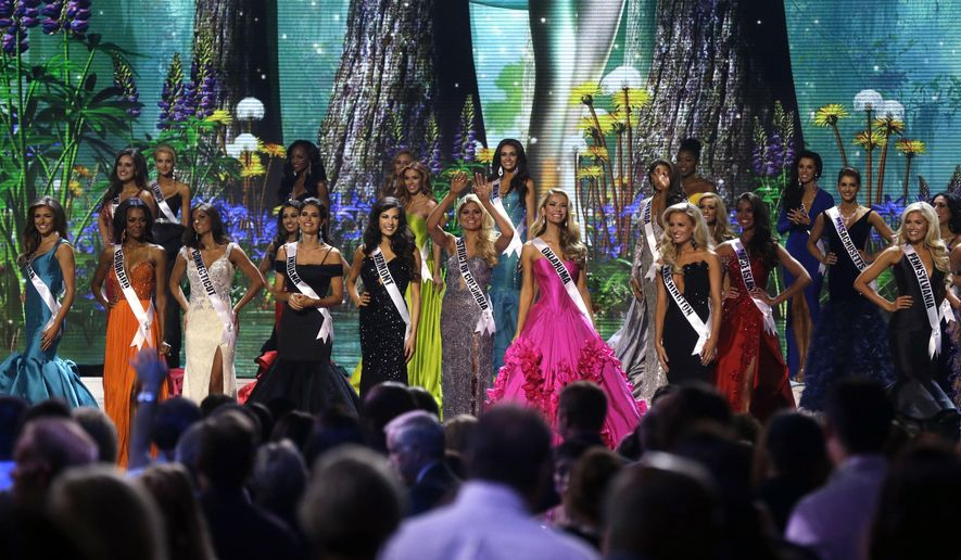 FILE - In this July 8, 2015 file photo, contestants wave onstage at the conclusion of the preliminary round of the 2015 Miss USA Pageant in Baton Rouge, La. The pageant co-owned by Donald Trump takes place in Baton Rouge for the second year in a row on Sunday night, July 12, 2015. (AP Photo/Gerald Herbert, File)