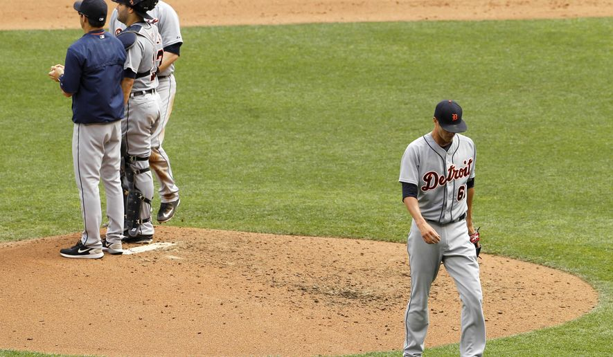 Detroit Tigers starting pitcher Shane Greene, right, walks away from the mound after being replaced by Ian Krol during the fifth inning of a baseball game against the Minnesota Twins in Minneapolis, Sunday, July 12, 2015. The Twins won 7-1. (AP Photo/Ann Heisenfelt)