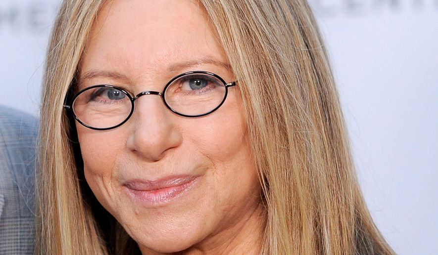 Barbra Streisand poses at the dedication of the Barbra Streisand Women's Heart Center in the Cedars-Sinai Heart Institute, on Thursday June 14, 2012, at Streisand's home in Malibu, Calif. (Photo by Chris Pizzello/Invision/AP) ** FILE **