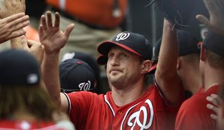 Washington Nationals pitcher Max Scherzer is congratulated after pitching into the ninth inning of a baseball game against the Baltimore Orioles,  Sunday, July 12, 2015, in Baltimore. The Nationals won 3-2. (AP Photo/Gail Burton)