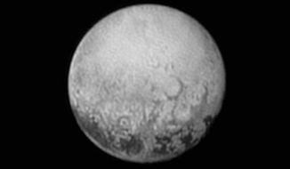 This July 11, 2015, image provided by NASA shows Pluto from the New Horizons spacecraft. (Associated Press)