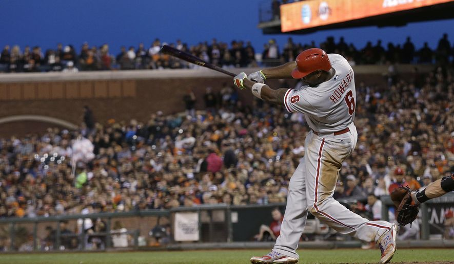 Philadelphia Phillies' Ryan Howard hits a solo home run off San Francisco Giants pitcher Ryan Vogelsong during the sixth inning of a baseball game in San Francisco, Saturday, July 11, 2015. (AP Photo/Jeff Chiu)