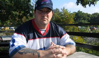 """FILE - In this Oct. 1, 2006 file photo, Army Sgt. Patrick Hart poses for a photo in Toronto. In 2006 Hart had deserted the Army and was living as a """"war resister"""" in Canada. Since then, he turned himself in to the U.S. Army, was convicted of desertion and served time in a military prison. (AP Photo/Harry Rosettani, File)"""
