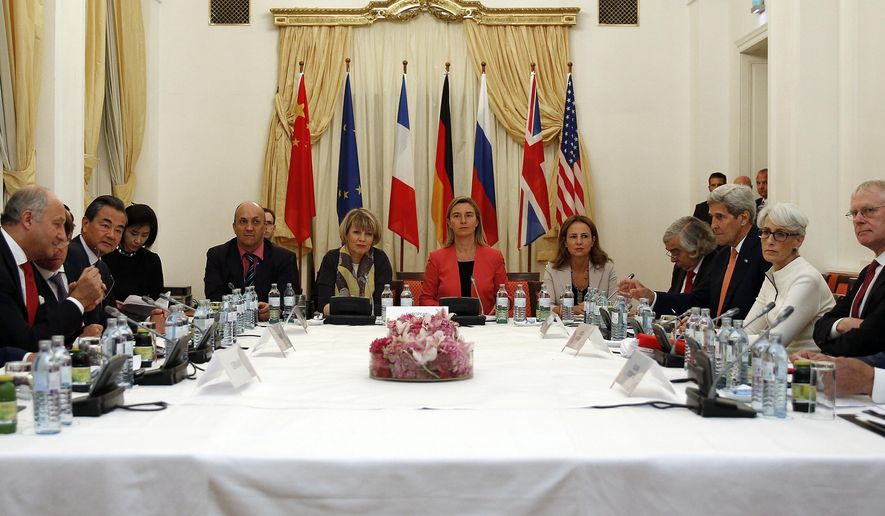 German Foreign Minister Frank-Walter Steinmeier, left, French Foreign Minister Laurent Fabius, 2nd left, Chinese Foreign Minister Wang Yi, 3rd left, European Union foreign policy chief Federica Mogherini,  centre in red, U.S. Secretary of State John Kerry, 4th right, and Russian Foreign Minister Sergei Lavrov, right, meet at a hotel in Vienna Monday July 13, 2015.  Negotiators at the Iran nuclear talks plan to announce Monday that they've reached a historic deal capping nearly a decade of diplomacy that would curb the country's atomic program in return for sanctions relief, two diplomats told The Associated Press on Sunday. Other attendees at meeting not Identified.  (Carlos Barria/Pool Photo, via AP)