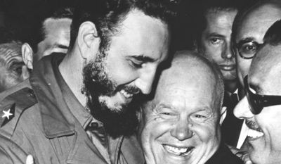 Cuban leader Fidel Castro, left, and Soviet leader Nikita Khrushchev hug at the United Nations in late 1960. (AP Photo/Marty Lederhandler)