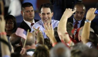 Wisconsin Gov. Scott Walker made clear that he plans to distinguish himself in a crowded field of 15 to 17 candidates by embracing conservative policy prescriptions, regardless of their perceived popularity in the media and polls. (Associated Press)