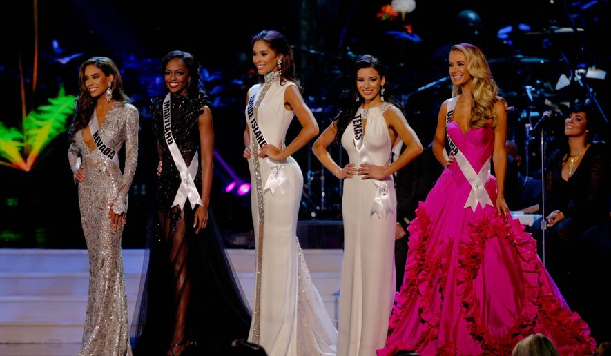 Miss Nevada Brittany McGowan, Miss Maryland Mame Adjei, Miss Rhode Island Anea Garcia, Miss Texas Ylianna Guerra and Miss Oklahoma Olivia Jordan competes during the 2015 Miss USA pageant in Baton Rouge, La., Sunday, July 12, 2015. (AP Photo/Derick E. Hingle)