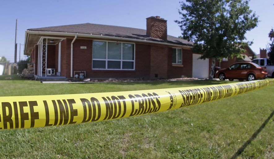 FILE - This June 22, 2015 file photo shows police tape hanging in front of a home where a Utah family of four was found shot to death in Roy, Utah. A Utah woman was considering leaving her husband before he fatally shot her, their two children and himself on Father's Day, according to police documents released Monday, July 13, 2015. (AP Photo/Rick Bowmer, file)