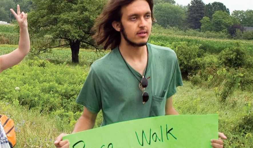In this July 26, 2012 photo provided by the Northumberland News, Alexander Ciccolo participates in a peace walk through Brighton, Ontario. Law enforcement officials say Ciccolo was arrested after his father, a Boston police captain, alerted authorities that his son was talking about joining the Islamic State group and setting off bombs. (Dave Fraser/Northumberland News via AP) MANDATORY CREDIT