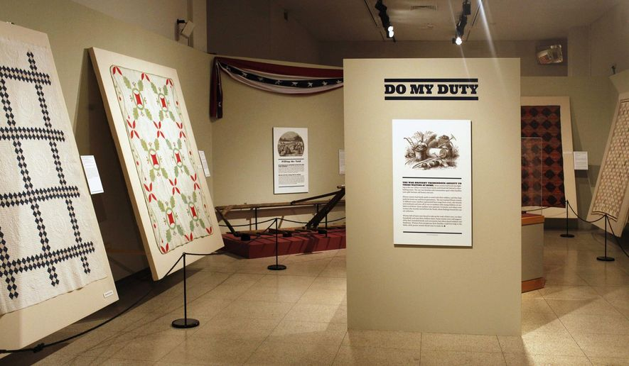 "FILE - This April 19, 2013 file photo shows quilts the exhibit ""Civil War Quilters: Loyal Hearts of Illinois"" at the Illinois State Museum in Springfield, Ill. On Monday, July 13, 2015, members of the public will have a chance to testify before the Commission on Government Forecasting and Accountability on Gov. Bruce Rauner's push to close the museum. Rauner announced he wanted to close the institution to save about $4.8 million at a time when Illinois is struggling financially. (Rich Saal/The State Journal-Register via AP, File)"