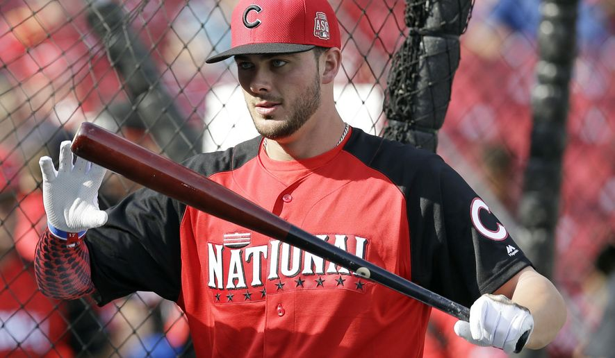 National League's Kris Bryant, of the Chicago Cubs, holds his bat during batting practice for the MLB All-Star baseball game, Monday, July 13, 2015, in Cincinnati. (AP Photo/John Minchillo)