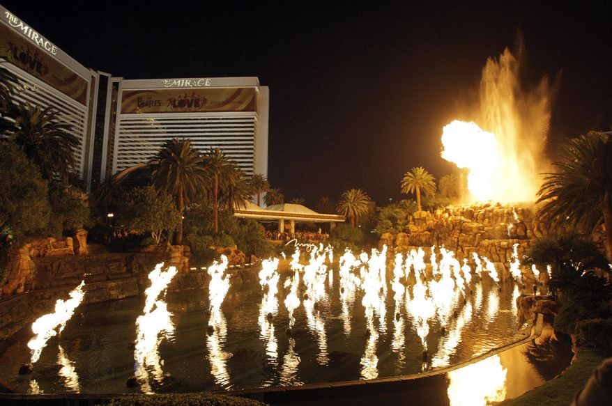FILE - In this Dec. 8, 2008 file photo, the Mirage Volcano erupts at the Mirage hotel and casino in Las Vegas. The man-made volcano that has been spewing fire and water since the hotel's 1989 opening will now offer two to three free nightly shows. Before Monday the volcano erupted every half-hour beginning at about dusk until midnight, wind permitting. (AP Photo/Jae C. Hong)