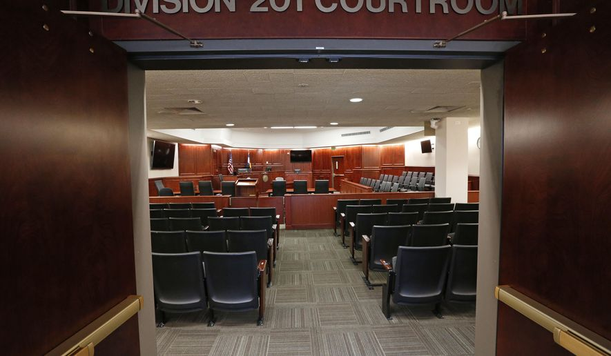 FILE - In this Jan. 15, 2015 file photo, a view inside Courtroom 201, where closing arguments in the trial of Aurora movie theater shootings defendant James Holmes are to take place on July 14, 2015, at the Arapahoe County District Court in Centennial, Colo. Jurors in the Colorado theater shooting trial soon will retreat into the largest jury room in the courthouse to determine whether  Holmes was legally insane at the time of the killing spree. (AP Photo/Brennan Linsley, pool, file)