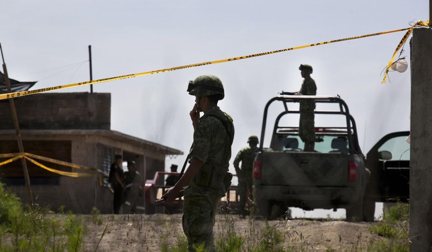 Soldiers guard a half-built house near the Altiplano maximum security prison in Almoloya, west of Mexico City, Monday, July 13, 2015. (AP Photo/Marco Ugarte) ** FILE **