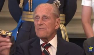 "Prince Philip was having his picture taken alongside veterans of the Battle of Britain when the nonagenarian decided he had enough and snapped at the photographer to ""just taking the f---ing picture."" (YouTube/The Royal Family Channel)"