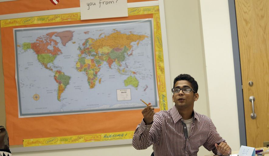 In this Thursday, July 9, 2015 photo, a student Enoush Younus participates in the High School 1 class at the Refugee Youth Summer Academy, in New York.  (AP Photo/Mary Altaffer)