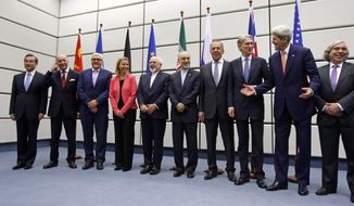 From left to right,  Chinese Foreign Minister Wang Yi, French Foreign Minister Laurent Fabius, German Foreign Minister Frank Walter Steinmeier, European Union High Representative for Foreign Affairs and Security Policy Federica Mogherini, Iranian Foreign Minister Mohammad Javad Zarif, Head of the Iranian Atomic Energy Organization Ali Akbar Salehi, Russian Foreign Minister Sergey Lavrov, British Foreign Secretary Philip Hammon, U.S. Secretary of State John Kerry and U.S. Secretary of Energy Ernest Moniz pose for a group picture at the United Nations building in Vienna, Austria, Tuesday, July 14, 2015.  After 18 days of intense and often fractious negotiation, world powers and Iran struck a landmark deal Tuesday to curb Iran's nuclear program in exchange for billions of dollars in relief from international sanctions ó an agreement designed to avert the threat of a nuclear-armed Iran and another U.S. military intervention in the Muslim world. (Carlos Barria, Pool Photo via AP)
