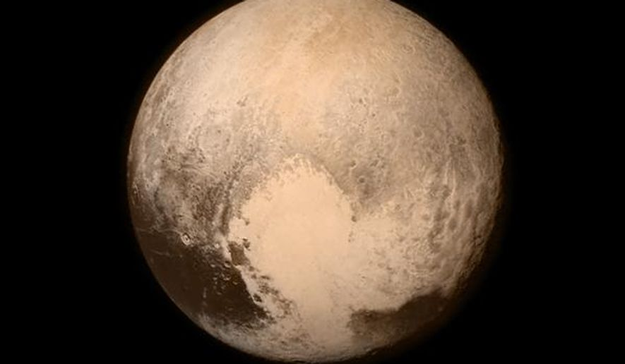 This July 13, 2015, image provided by NASA shows Pluto, seen from the New Horizons spacecraft. The United States is now the only nation to visit every single planet in the solar system. Pluto was No. 9 in the lineup when New Horizons departed Cape Canaveral, Fla, on Jan. 19, 2006  (NASA via AP)