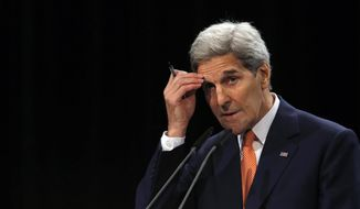 U.S. Secretary of State John Kerry delivers a statement on the Iran talks deal at the Vienna International Center in Vienna, Austria Tuesday July 14, 2015.  After 18 days of intense and often fractious negotiation, world powers and Iran struck a landmark deal Tuesday to curb Iran's nuclear program in exchange for billions of dollars in relief from international sanctions ó an agreement designed to avert the threat of a nuclear-armed Iran and another U.S. military intervention in the Muslim world. (Carlos Barria, Pool Photo via AP)