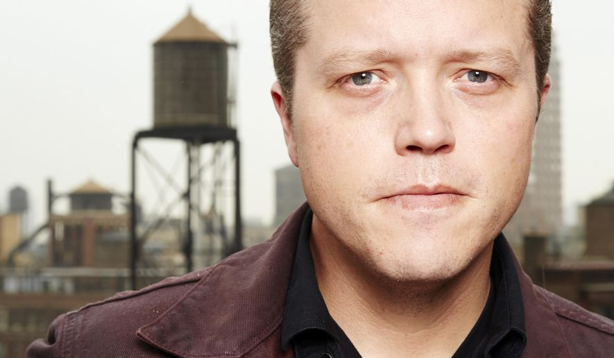 """In this May 19, 2015 file photo, American singer-songwriter Jason Isbell poses for a portrait in promotion of his upcoming solo album """"Something More Than Free"""" at the NYLO hotel, in New York. (Photo by Dan Hallman/Invision/AP)"""