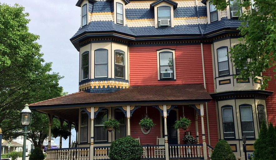 This June 26, 2015 photo shows Columbia House on Ocean Street in Cape May, N.J. The house is one of hundreds of late 19th century structures included in Cape May, N.J.'s National Historic Landmarks designation. The Victorian houses' gables, towers, domes, arched windows and inviting front porches, often trimmed in bright colors, create charming and whimsical streetscapes. (AP Photo/Beth J. Harpaz)