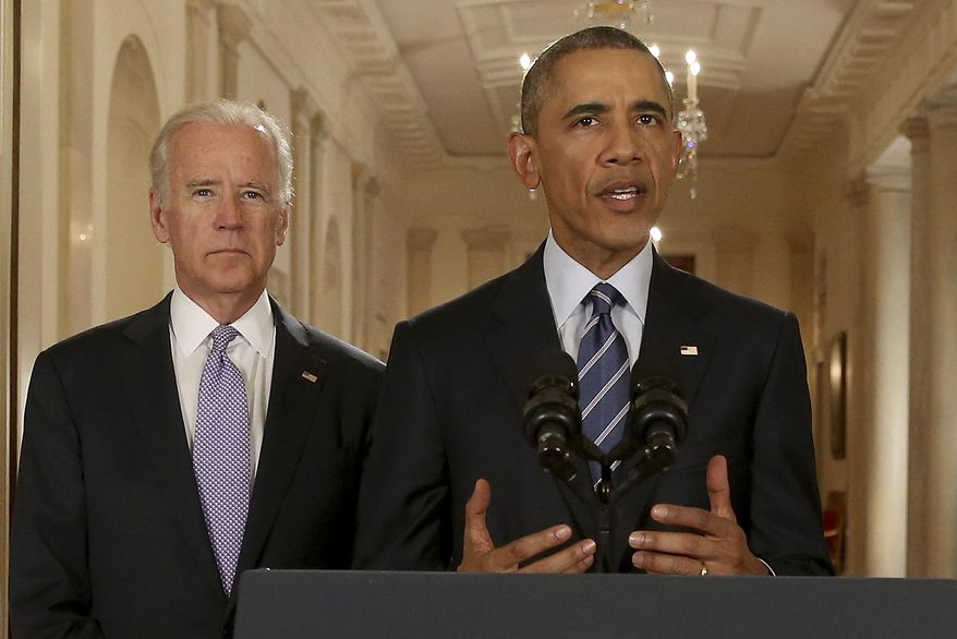 President Barack Obama, standing with Vice President Joe Biden, delivers remarks in the East Room of the White House in Washington, Tuesday, July 14, 2015, after an Iran nuclear deal is reached. After 18 days of intense and often fractious negotiation, diplomats Tuesday declared that world powers and Iran had struck a landmark deal to curb Iran's nuclear program in exchange for billions of dollars in relief from international sanctions. (AP Photo/Andrew Harnik, Pool)