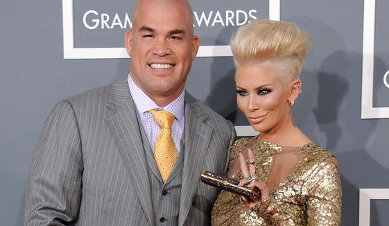 This Feb. 10, 2013 file photo Tito Ortiz, left, and now ex-girlfriend Jenna Jameson arrive at the 55th annual Grammy Awards in Los Angeles. (Photo by Jordan Strauss/Invision/AP, File)