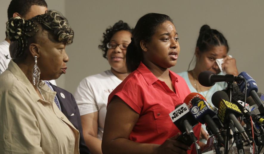 Eric Garner's daughter Erica Garner, center is joined by his mother Gwen Carr, left,  second from left, daughter Emerald Snipes, second from right, and wife Esaw Snipes, as she speaks during a news conference, Tuesday, July 14, 2015, in New York. The family of Garner, a black man who died after being placed in a white police officer's chokehold, discussed the $5.9 million settlement it reached with the city days before the anniversary of his death. (AP Photo/Mary Altaffer)