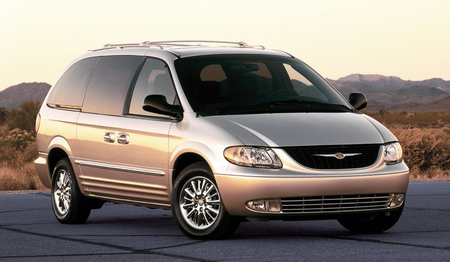 This product image provided by Fiat Chrysler Automobiles shows a 2002 Chrysler Town and Country minivan. U.S. safety regulators are investigating inflators made by ARC Automotive Inc. that went into about 420,000 2002 Fiat Chrysler Town and Country minivans, and another 70,000 2004 Kia Optima midsize sedans, according to documents posted Tuesday, July 14, 2015 by the National Highway Traffic Safety Administration. (Fiat Chrysler Automobiles via AP)