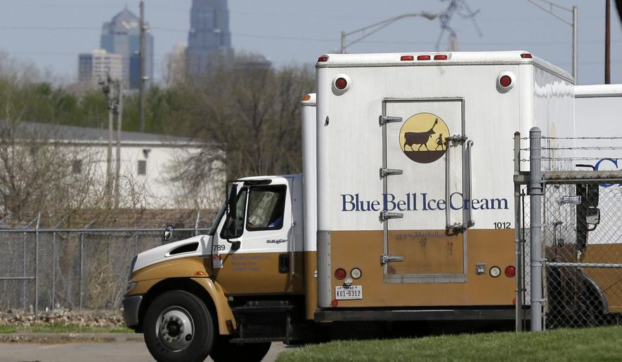 "FILE - In this April 10, 2015 file photo, Blue Bell delivery trucks are parked at the creamery's location in Kansas City, Kansas. Blue Bell Creameries announced on Tuesday, July 14, 2015, that an investment by prominent Texas businessman Sid Bass will ""ensure"" the return of its ice cream products to the market. Blue Bell released a statement Tuesday announcing Bass has become a partner.   (AP Photo/Orlin Wagner, File)"