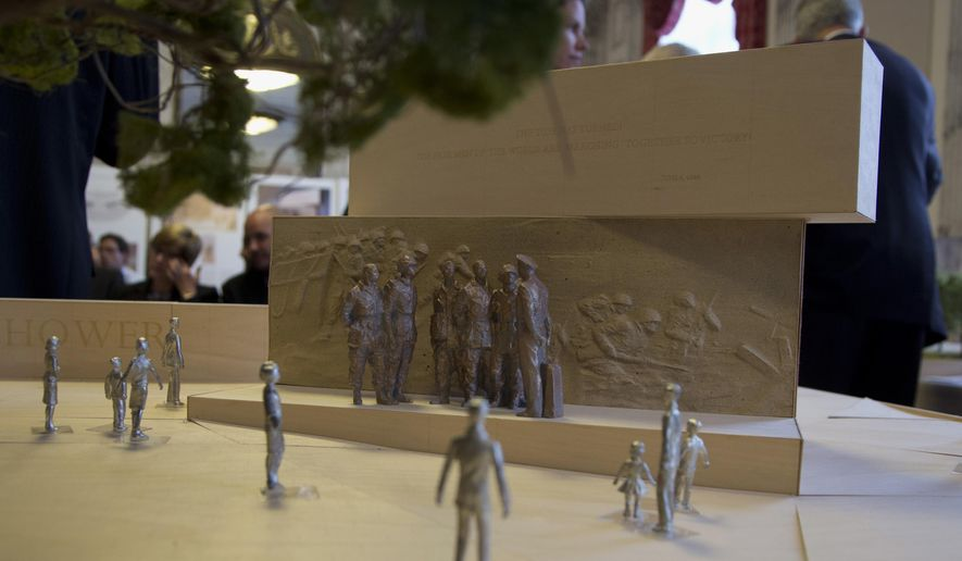 FILE - In this June 19, 2013 file photo, a portion of a model of  a memorial honoring Dwight D. Eisenhower is seen during a public meeting of the Eisenhower Memorial Commission on Capitol Hill in Washington. Taiwan is pledging $1 million to help build a memorial honoring U.S. President Dwight D. Eisenhower in Washington as the project organizers begin a fundraising campaign to complete the monument.  (AP Photo/Carolyn Kaster, File)