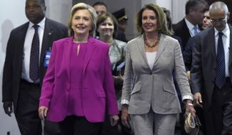 Democratic presidential candidate Hillary Rodham Clinton walks with House Minority Leader Nancy Pelosi of California on Capitol Hill in Washington on July 14, 2015. Clinton is attend meetings on Capitol Hill with House and Senate Democrats. (Associated Press) **FILE**