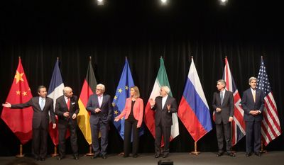 From left: Chinese Foreign Minister Wang Yi, French Foreign Minister Laurent Fabius, German Foreign Minister Frank-Walter Steinmeier, European Union High Representative Federica Mogherini, Iranian Foreign Minister Mohammad Javad Zarif, British Foreign Secretary Philip Hammond and U.S. Secretary of State John F. Kerry pose for a group photo after talks with Iran on their nuclear program in Vienna. (AP Photo)